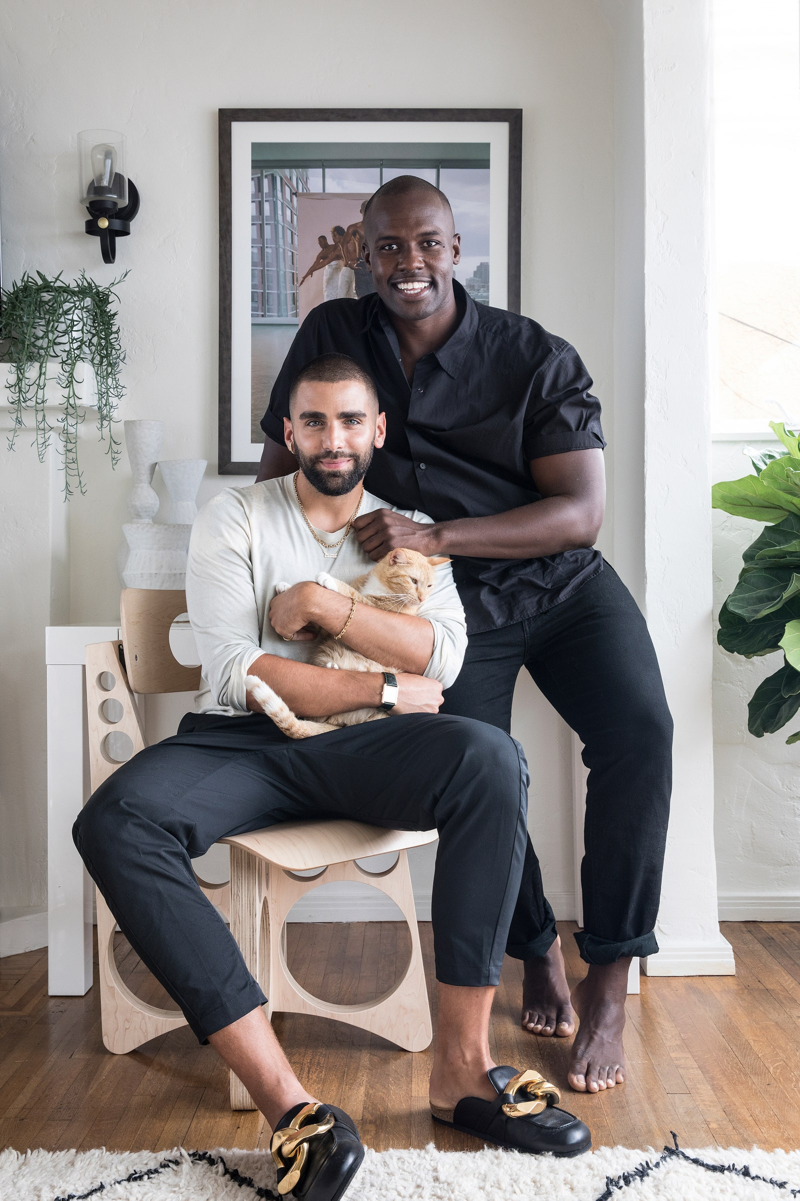 Newly minted Angelenos Phillip (left) and Darien pose with their cat.